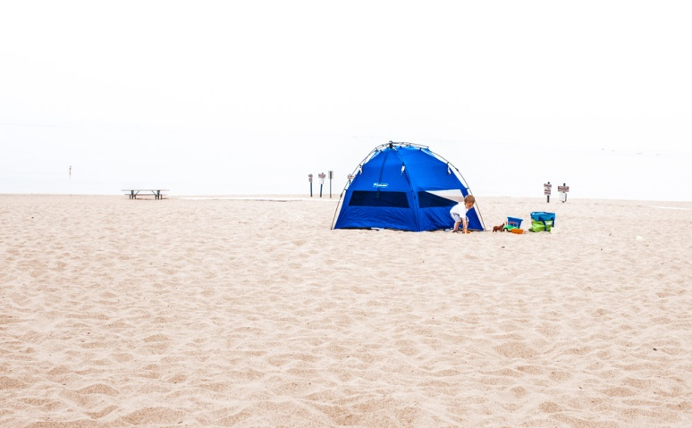 Blue Tent on the beach with child