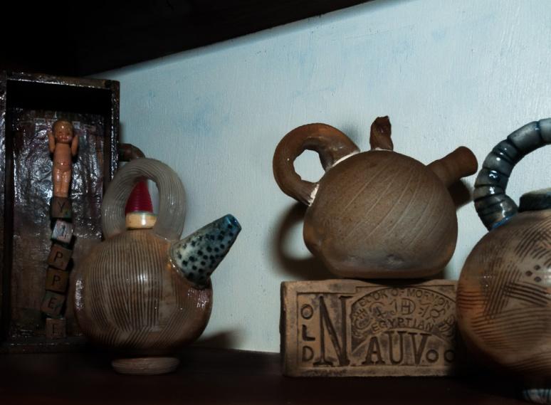 Tea Pots on a Shelf
