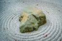 A green stone in a white garden