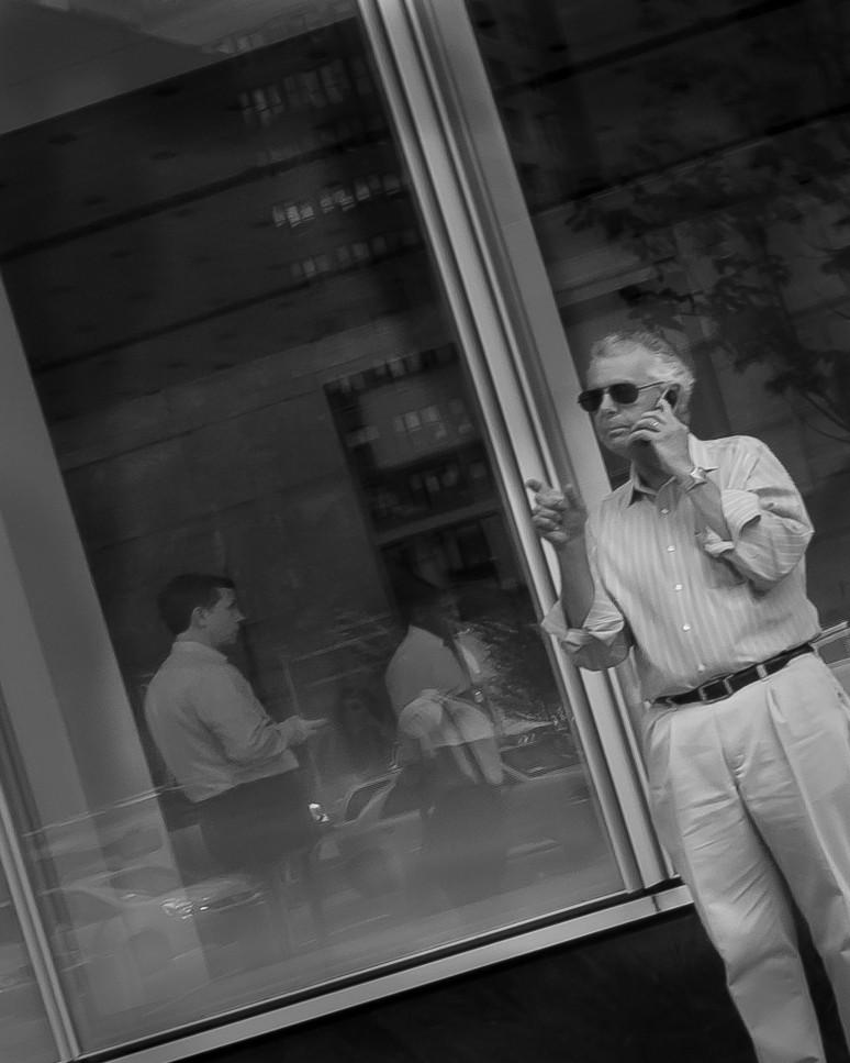 Man on a phone making a desicion.